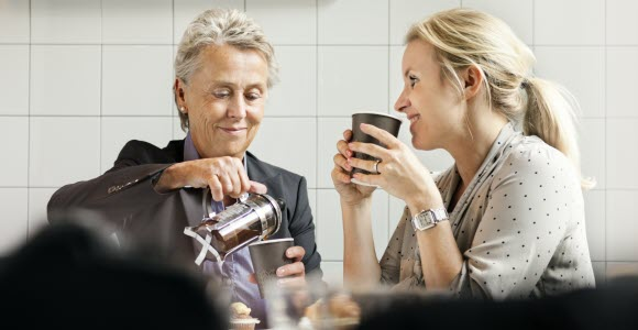Photo: Two women having coffee