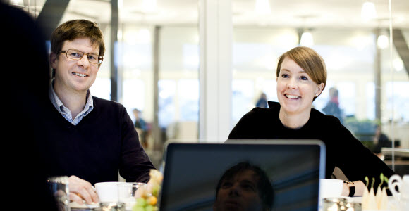 Photo: Man and woman in a meeting, smiling
