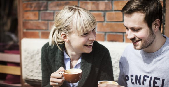 Photo: Woman and man having coffee, outdoor